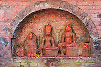 Nepal, Kathmandu.   A Shrine Dated to the pre-Lichchhavi Period, probably 3rd. Century A.D.  Offerings of Rice and Flower Petals.