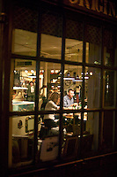 People dining at oyster bar inside Union Bay Oyster House, Boston, M