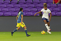ORLANDO, FL - JANUARY 22: Catarina Macario #29 looks to beat Carolina Arias #17 on the flank during a game between Colombia and USWNT at Exploria stadium on January 22, 2021 in Orlando, Florida.