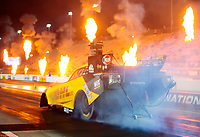Oct 11, 2019; Concord, NC, USA; Pyrotechnics and fire go off as NHRA funny car driver J.R. Todd does a burnout during qualifying for the Carolina Nationals at zMax Dragway. Mandatory Credit: Mark J. Rebilas-USA TODAY Sports