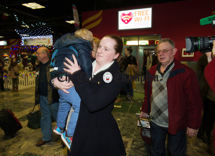 Vanessa Bodie gets a hug from her nephew Rhys Bodie as she arrives home for Christmas to Shannon airport. Photograph by John Kelly.