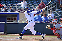 Brett Eibner #8 of the Omaha Storm Chasers swings against the Memphis Redbirds at Werner Park on April 9, 2014 in Omaha, Nebraska. The Storm Chasers beat the Redbirds 20-3.   (Dennis Hubbard/Four Seam Images)