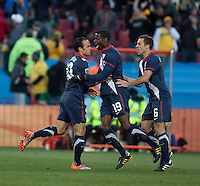 The USA's Landon Donovan celebrates scoring the USA's first goal with teammate Maruice Edu and Steve Cherundolo in the second half of the 2010 World Cup match between USA and Slovenia at Ellis Park Stadium in Johannesburg, South Africa on Friday, June 18, 2010.  The USA tied Slovenia 2-2.