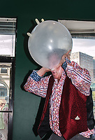Scott, a performer at Coney Island's Circus Sideshow, inflates balloon by blowing through his nose until balloon bursts.