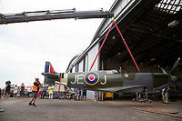 BNPS.co.uk (01202) 558833. <br /> Pic: CorinMesser/BNPS<br /> <br /> Pictured: Crews lift the Spitfire into the hanger. <br /> <br /> A full-sized model Spitfire has been built as a memorial to the women and children who constructed over 2,000 of them in secret during World War Two.<br /> <br /> The crucial little-known operation involved just a few hundred people who operated in requisitioned car garages, sheds, workshops and factories in the city of Salisbury, Wilts.<br />  <br /> They had to sign of Official Secrets Act and worked with such discretion that the Wiltshire city's inhabitants were oblivious to it.<br /> <br /> They built the legendary aircraft in piecemeal, with the parts coming together to be assembled in one large factory that is now the local rugby club.