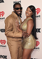 """HOLLYWOOD, CA - MAY 27:  Pardison Fontaine and Megan Thee Stallion at the 2021 """"iHeartRadio Music Awards"""" airing live from The Dolby Theatre in Los Angeles, Thursday, May 27 (8:00-10:00 PM ET live / PT tape-delayed) on FOX. CR: Scott Kirkland/FOX/PictureGroup © 2021 FOX MEDIA, LLC. (Photo by Scott Kirkland/FOX/PictureGroup)"""