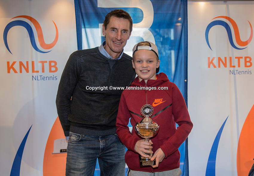 Hilversum, Netherlands, December 4, 2016, Winter Youth Circuit Masters, 2 nd th place boys 12 years Abel Forger with Fedcup captain Paul Haarhuis.   <br /> Photo: Tennisimages/Henk Koster