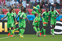 Ahmed Musa of Nigeria celebrates scoring a goal with team mates after making it 1-1