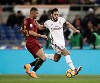 Calcio, Serie A: AS Roma - AC Milan, Roma, stadio Olimpico, 25 febbraio, 2018.<br /> Milan's Hakan Calhanoglu (r) in action with Roma's Bruno Peres (l) during the Italian Serie A football match between AS Roma and AC Milan at Rome's Olympic stadium, February 28, 2018.<br /> UPDATE IMAGES PRESS/Isabella Bonotto