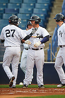 Tampa Yankees third baseman Miguel Andujar (27) congratulated by Mike Ford (25) after hitting a home run during a game against the Bradenton Marauders on April 11, 2016 at George M. Steinbrenner Field in Tampa, Florida.  Tampa defeated Bradenton 5-2.  (Mike Janes/Four Seam Images)