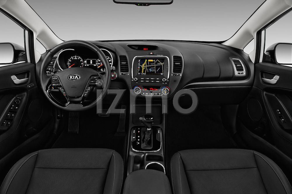 Stock photo of straight dashboard view of 2018 KIA Forte EX-AT 4 Door Sedan Dashboard