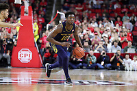 RALEIGH, NC - JANUARY 9: T.J. Gibbs #10 of the University of Notre Dame brings the ball up the court during a game between Notre Dame and NC State at PNC Arena on January 9, 2020 in Raleigh, North Carolina.