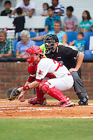 Johnson City Cardinals catcher Charlie Neil (32) on defense as home plate umpire Brock Ballou looks on during the game against the Elizabethton Twins at Cardinal Park on July 27, 2014 in Johnson City, Tennessee.  The game was suspended in the top of the 5th inning with the Twins leading the Cardinals 7-6.  (Brian Westerholt/Four Seam Images)