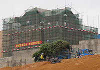 20120116 CHINA GUANGDONG PROVINCE : A tree is transported by a truck on the construction site of Hallstatt, China's copy of the Austrian alpine town of the same name, Boluo Township, Huizhou City, Guangdong Province, China, 16 January 2012. Property developments such as this are expected to run into financial difficulites in 2012 as the Chinese economy and property market continue to cool, in reaction to the ongoing sovereign debt crisis in Europe.<br /> SINOPIX / ALEX HOFFORD
