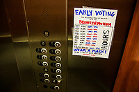 NEW YORK, NY - OCTOBER 24: View of voting hours in an elevator near the Brooklyn Museum during early voting for the United States presidential election on October 24, 2020 in New York City. Due to concerns about the coronavirus and social distancing, New York State is allowing early voting for the first time to protect voters from new infections in the city (Photo by Pablo Monsalve / VIEWpress via Getty Images)
