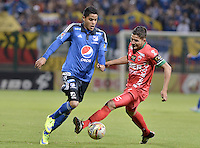 BOGOTA - COLOMBIA -06 -08-2015: Larry Vasquez (Der) jugador de Patriotas FC disputa el balón con Kevin Rendon (Izq) jugador de Millonarios durante partido por la fecha 2 de la Liga Águila II 2015 jugado en el estadio Metropolitano de Techo de la ciudad de Bogotá./  Larry Vasquez (R) player of Patriotas FC fights the ball with Kevin Rendon (L) player of Millonarios during match for the second date of the Aguila League II 2015 played at Metropolitan de Techo stadium in Bogotá city. Photo: VizzorImage / Gabriel Aponte / Staff.