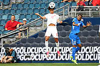 KANSASCITY, KS - JULY 11: Tajon Buchanan #12 of Canada heads the ball during a game between Canada and Martinique at Children's Mercy Park on July 11, 2021 in KansasCity, Kansas.