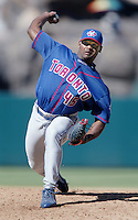 Kelvim Escobar of the Toronto Blue Jays pitches during a 2002 MLB season game against the Los Angeles Angels at Angel Stadium, in Anaheim, California. (Larry Goren/Four Seam Images)