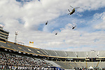 Military helicopters fly overhead before the Zaxby's Heart of Dallas Bowl game between the Army Black Knights and the North Texas Mean Green at the Cotton Bowl Stadium in Dallas, Texas.