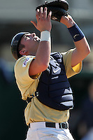 Catcher Kevin Griffin #31 of the West Virginia Mountaineers during the Big East-Big Ten Challenge vs. the Iowa Hawkeyes at Jack Russell Stadium in Clearwater, Florida;  February 18, 2011.  West Virginia defeated Iowa 5-0 in both teams opening games of the season.  Photo By Mike Janes/Four Seam Images