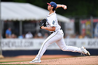 Asheville Tourists starting pitcher Riley Pint (32) delivers a pitch during a game against the Charleston RiverDogs at McCormick Field on July 4, 2017 in Asheville, North Carolina. The Tourists defeated the RiverDogs 2-1. (Tony Farlow/Four Seam Images)