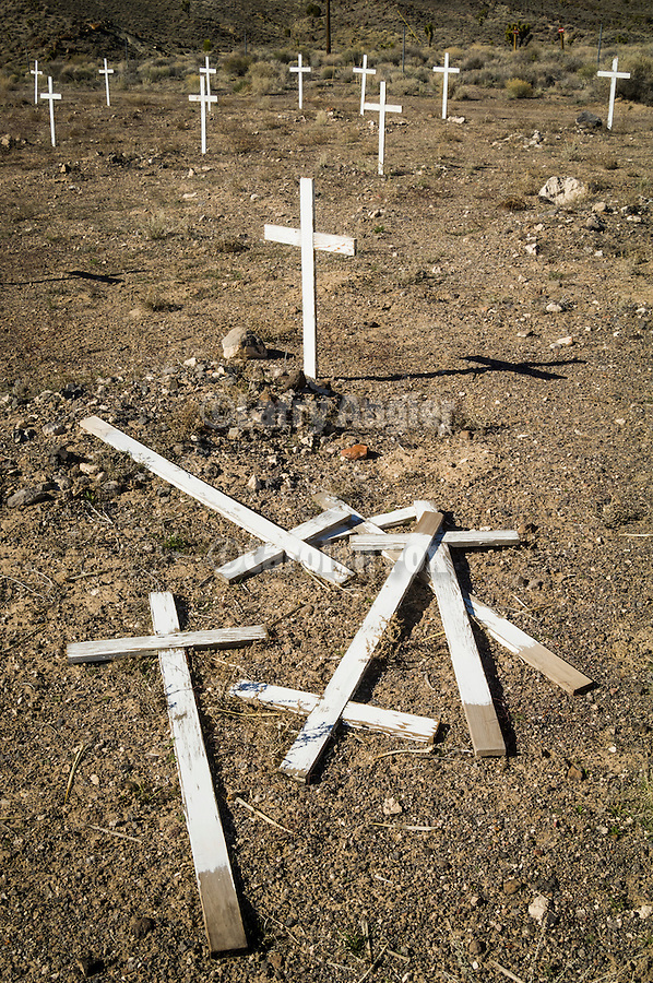 Historic early 1900s cemetery with a pile of crosses on the ground, Goldfield, Nev.