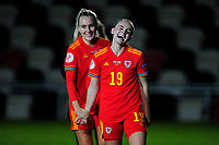 Josephine Green and Lilly Woodham of Wales Women's celebrate at full time during the UEFA Women's EURO 2022 Qualifier match between Wales Women and Faroe Islands Women at Rodney Parade in Newport, Wales, UK. Thursday 22 October 2020