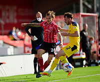 Lincoln City's Harry Anderson vies for possession with Oxford United's Sam Long<br /> <br /> Photographer Andrew Vaughan/CameraSport<br /> <br /> The EFL Sky Bet League One - Saturday 12th September  2020 - Lincoln City v Oxford United - LNER Stadium - Lincoln<br /> <br /> World Copyright © 2020 CameraSport. All rights reserved. 43 Linden Ave. Countesthorpe. Leicester. England. LE8 5PG - Tel: +44 (0) 116 277 4147 - admin@camerasport.com - www.camerasport.com - Lincoln City v Oxford United