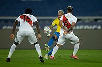5th July 2021; Nilton Santos Stadium, Rio de Janeiro, Brazil; Copa America, Brazil versus Peru; Neymar of Brazil clips the ball over the challenge of Trauco of Peru