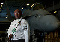 110929-N-DR144-495 PACIFIC OCEAN (Sept. 29, 2011) Logistics Specialist 1st Class Mesfin Marcos, Leading Petty Officer in charge of safety for Strike Fighter Squadron (VFA) 25, holds a model of a Russian-built Mig-21 fighter aircraft used to train Carrier Air Wing 17 pilots in air-to-air combat aboard Nimitz-class aircraft carrier USS Carl Vinson (CVN 70).  Marcos flew the Mig-21 as a pilot in the Ethiopian National Defense Force from 1986 to 1989 before defecting from the country, which was then ruled by a military communist dictatorship, and eventually enlisting in the U.S. Navy in 1994. Marcos remains an avid recreational pilot and intends to pursue a career in civil aviation when he retires from the Navy. Carl Vinson and Carrier Air Wing 17 are underway conducting operations off the coast of Southern California.  U.S. Navy photo by Mass Communication Specialist 2nd Class James R. Evans (RELEASED)