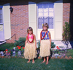 Tracey and April Wild in hula skirt costumes. 1973