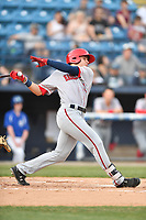 Hagerstown Suns right fielder Jacob Rhinesmith (13) swings at a pitch during a game against the Asheville Tourists at McCormick Field on April 30, 2019 in Asheville, North Carolina. The Tourists defeated the Suns 5-4. (Tony Farlow/Four Seam Images)