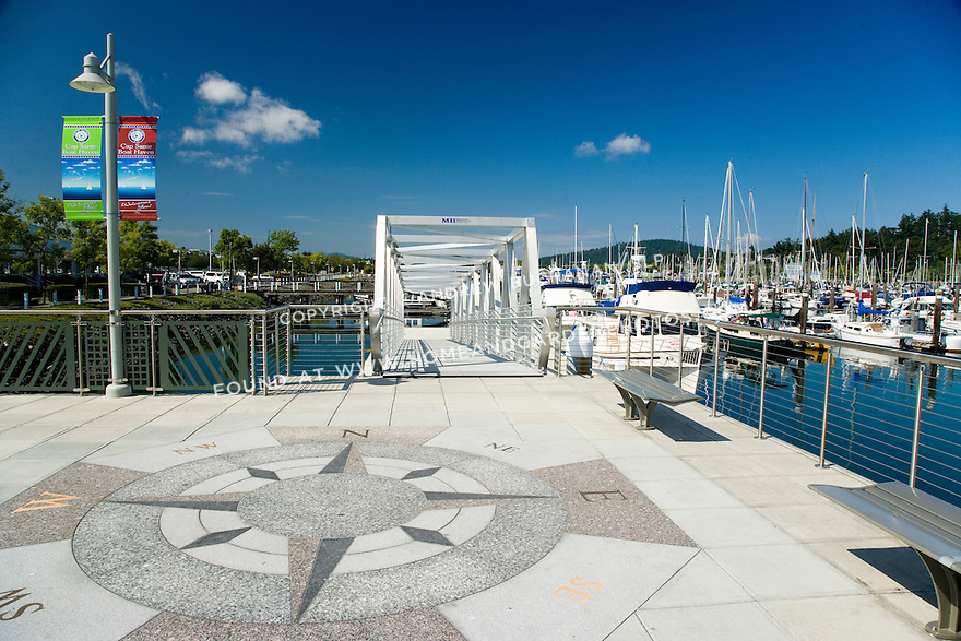 A decorative compass rose adds interesting detail to the plaza area of a public marina in Washington state.