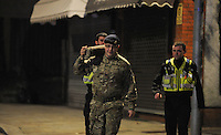 Wednesday 11 January 2017<br /> Pictured: Police and the Bomb Squad with the bomb at the scene<br /> Re: A World War One bomb which was taken into a Neath Port Talbot pub has been removed and people allowed back home.<br /> South Wales Police evacuated residents in Herbert Street, Pontardawe, at about 19:30 GMT on Wednesday after the device was brought into the Pink Geranium pub before being taken outside.<br /> The Army's ordnance disposal team was called to remove it.<br /> Just after midnight on Thursday, police said the bomb had been taken away and the area declared safe.