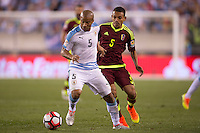 Action photo during the match Uruguay vs Venezuela at Lincoln Financial Field Stadium Copa America Centenario 2016. ---Foto  de accion durante el partido Uruguay vs Venezuela, En el Estadio Lincoln Financial Field Partido Correspondiante al Grupo - C -  de la Copa America Centenario USA 2016, en la foto: (I)-(D) Carlos Sanchez, Arquimedes Figuera<br /> --- 09/06/2016/MEXSPORT/Osvaldo Aguilar.