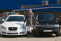 Krasnodar, Russia, 17/03/2009..World champion heptathlete Tatyana Chernova with her favourite car, a Jaguar, and the BMW X3 given to her by Russian President Dmitri Medvedev. Chernova, who won bronze in the Beijing Olympic Games, is tipped for gold in London.