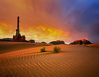 Sunrise and sand dunes with Totem Pole. Monument Valley, Arizona