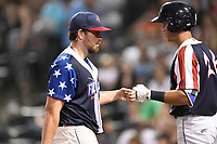 Starting pitcher Blake Taylor (28) of the Columbia Fireflies is greeted after coming out of a game against the Rome Braves on Monday, July 3, 2017, at Spirit Communications Park in Columbia, South Carolina. Columbia won, 1-0. (Tom Priddy/Four Seam Images)