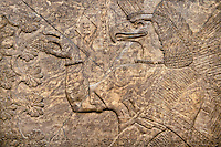 Assyrian relief sculpture panel of an eagle headed  protective spirit holding a symbolic cone.  From Nimrud, Iraq,  865-860 B.C North West Palace, room F, panel 8.  British Museum Assyrian  Archaeological exhibit no WA 118804.