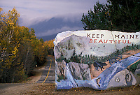 "AJ2231, Maine, Beautiful painted rock """"Keep Maine Beautiful"""" next to a road in northern Maine in autumn at entrance of Baxter State Park."