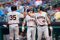 Aberdeen IronBirds designated hitter Alexis Torres (35) is congratulated by Cody Roberts (48) and Adam Hall (1) as he crosses home plate after hitting a home run in the top of the first inning during a game against the Tri-City ValleyCats on August 27, 2018 at Joseph L. Bruno Stadium in Troy, New York.  Aberdeen defeated Tri-City 11-5.  (Mike Janes/Four Seam Images)