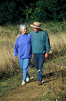 Senior couple walking  on path, Cape Cod, MA<br />