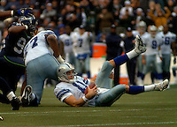 Oct 23, 2005; Seattle, Wash, USA;  Dallas Cowboys quarterback #11 Drew Bledsoe is sacked by the Seattle Seahawks in the fourth quarter at Qwest Field. Mandatory Credit: Photo By Mark J. Rebilas