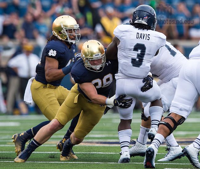 Aug. 30, 2014; Rice Owls running back Jowan Davis (3) is tackled by Notre Dame Fighting Irish linebacker Joe Schmidt (38) in the first quarter..Photo by Matt Cashore
