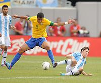 Brazil midfielder Romulo (8) goes against Argentina defender Federico Fernandez (17) The Argentina National Team defeated Brazil 4-3 at MetLife Stadium, Saturday July 9 , 2012.