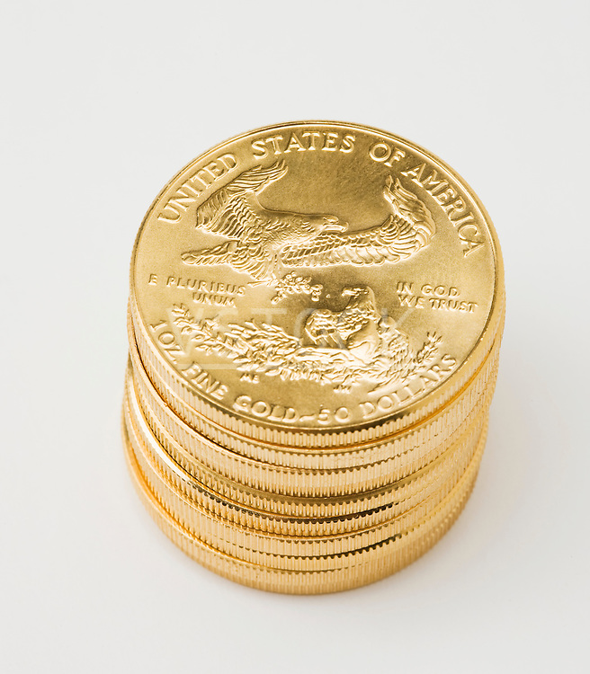 Stack of golden American coins on white background