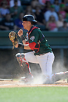 Catcher Carlos Coste (7) of the Greenville Drive pumps his fist after tagging a runner out at the plate in a game against the Savannah Sand Gnats on Sunday, June 22, 2014, at Fluor Field at the West End in Greenville, South Carolina. Greenville won, 7-3. (Tom Priddy/Four Seam Images)