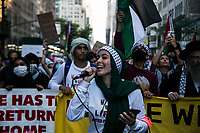NEW YORK, NY - JUNE 15: A Pro-Palestinian woman speaks into a microphone during a large protest in New York on June 15, 2021. The solidarity action of hundreds of pro-Palestinians is a form of support against the attacks that has been carried out by the Israeli government. At the same time, Palestinian Prime Minister Mohammad Shtayyeh says the new Israeli government is just as bad as the old one and condemns Naftali Bennett's announcements in support of Israeli settlements. That is why the demonstrations continue in different parts of the world. (Photo by Pablo Monsalve / VIEWpress via Getty Images