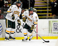18 October 2009: University of Vermont Catamount forward Brian Roloff (14), a Senior from West Seneca, NY, in action with defenseman Dan Lawson (28), a Junior from Oak Forest, IL, during the first period against the Boston College Eagles at Gutterson Fieldhouse in Burlington, Vermont. The Catamounts defeated the Eagles 4-1 to open Vermont's America East hockey season. Mandatory Credit: Ed Wolfstein Photo