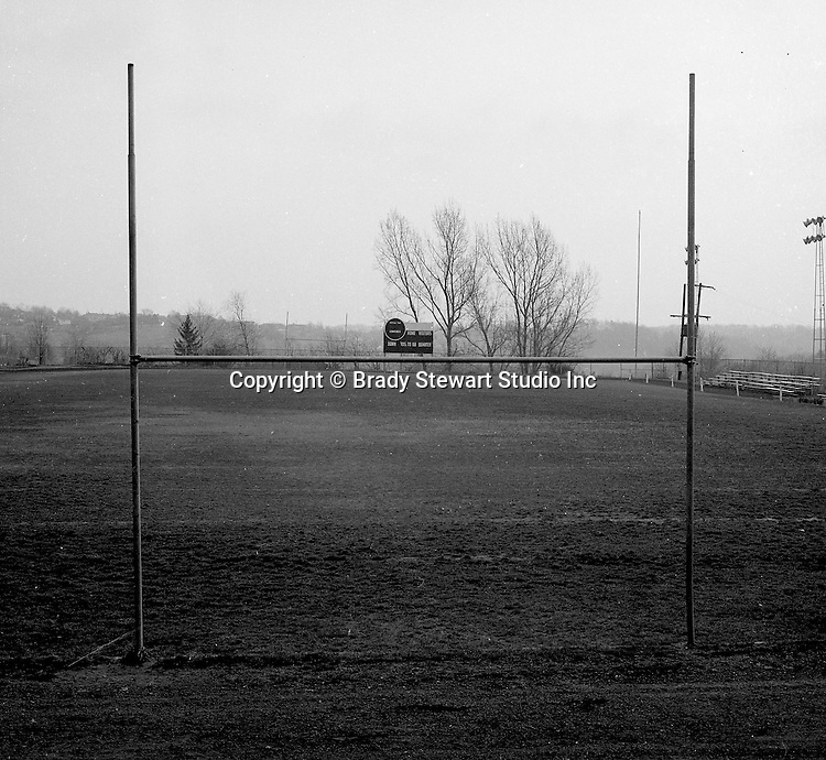Bethel Park PA: View of the Bethel Park High School football field. The field, lights, and stands were not good for a AA football program.  The coaches sent one of the managers over the hill (far end zone) to retrieve the footballs after an extra point or field goal.